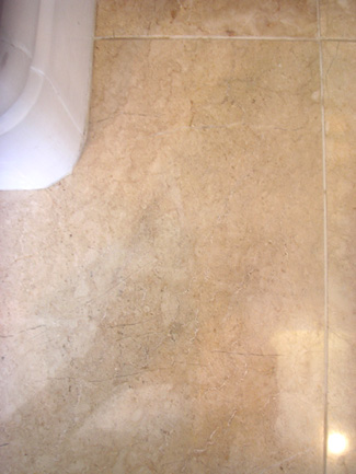 Scratch on marble tile restored