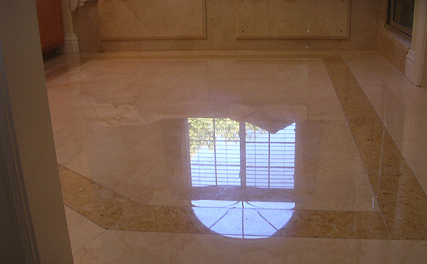 Crema Marfil and limestone shower, after stone restoration
