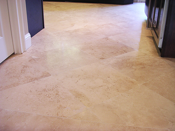 Travertine tile restoration, lippage removal